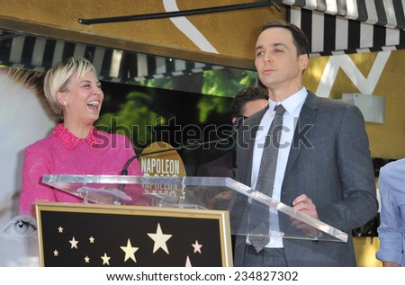 LOS ANGELES, CA - OCTOBER 29, 2014: Kaley Cuoco & co-stars from The Big Bang Theory - Jim Parsons & Simon Helberg - on Hollywood Blvd where she received a star on the Hollywood Walk of Fame.  - stock photo