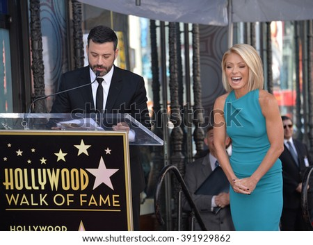 LOS ANGELES, CA - OCTOBER 12, 2015: Kelly Ripa & Jimmy Kimmel on Hollywood Boulevard where she was honored with a star on the Hollywood Walk of Fame. - stock photo