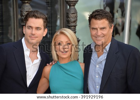 LOS ANGELES, CA - OCTOBER 12, 2015: Kelly Ripa with Matt Bomer (left) & Ted McGinley on Hollywood Boulevard where she was honored with a star on the Hollywood Walk of Fame. - stock photo