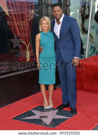 LOS ANGELES, CA - OCTOBER 12, 2015: Kelly Ripa with Michael Strahan on Hollywood Boulevard where she was honored with a star on the Hollywood Walk of Fame. - stock photo