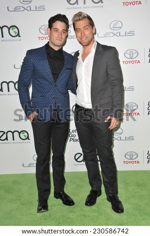 LOS ANGELES, CA - OCTOBER 18, 2014: Lance Bass & partner Michael Turchin (left) at the 2014 Environmental Media Awards at Warner Bros Studios, Burbank.  - stock photo