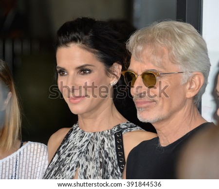"""LOS ANGELES, CA - OCTOBER 26, 2015: Sandra Bullock & Billy Bob Thornton at the premiere of """"Our Brand is Crisis"""" at the TCL Chinese Theatre, Hollywood. - stock photo"""