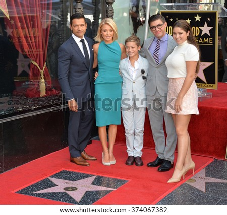 LOS ANGELES, CA - OCTOBER 12, 2015: TV personality Kelly Ripa & actor husband Mark Consuelos & children Joaquin, 12, Michael 18, & Lola, 14 honored with the 2,561st star on the Hollywood Walk of Fame  - stock photo