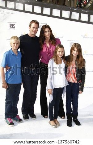 LOS ANGELES, CA - SEP 25: Cindy Crawford; Rande Gerber; son, daughter, friend at the IRIS, A Journey Through the World of Cinema by Cirque du Soleil premiere September 25, 2011 in Los Angeles, CA - stock photo