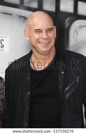 LOS ANGELES, CA - SEP 25: Guy Laliberte at the IRIS, A Journey Through the World of Cinema by Cirque du Soleil premiere September 25, 2011 at Kodak Theater in Los Angeles, California - stock photo