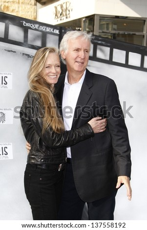 LOS ANGELES, CA - SEP 25: James Cameron; Suzy Amis at the IRIS, A Journey Through the World of Cinema by Cirque du Soleil premiere September 25, 2011 at Kodak Theater in Los Angeles, California - stock photo