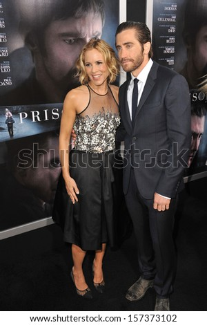 "LOS ANGELES, CA - SEPTEMBER 12, 2013: Maria Bello & Jake Gyllenhaal at the premiere of their movie ""Prisoners"" at the Academy of Motion Picture Arts & Sciences in Beverly Hills.  - stock photo"