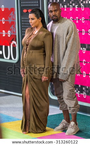 LOS ANGELES, CA/USA - AUGUST 30 2015: Kim Kardashian-West and Kanye West attend the 2015 MTV Video Music Awards at Microsoft Theater. - stock photo
