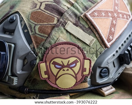 Los Angeles, CA, USA - March 17, 2016: Mil-Spec Monkey and confederate flag patches on a tactical battle helmet - stock photo