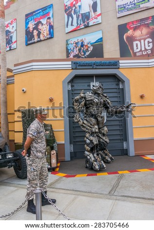 LOS ANGELES, CA/USA - MAY 24: Megatron of Transformers movie is welcoming tourists in front of the Transformers Ride at Universal studios hollywood on May 24, 2015 in Los Angeles, CA, USA. - stock photo