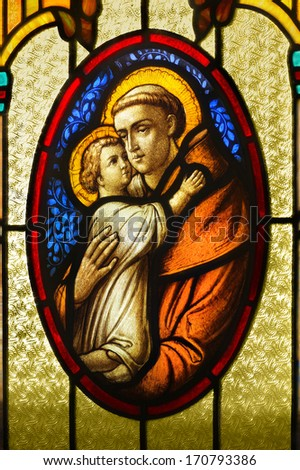 LOS ANGELES, CA, USA- NOVEMBER 27, 2013: Illustrative photo of a stained glass detail of Saint Anthony holding baby Jesus - stock photo