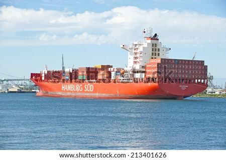LOS ANGELES/CALIFORNIA - AUGUST 24, 2014: Cargo ship from Southern Hamburg the largest port in Germany enters the Port of Los Angeles the largest port in USA July 24, 2014 in San Pedro, California USA
