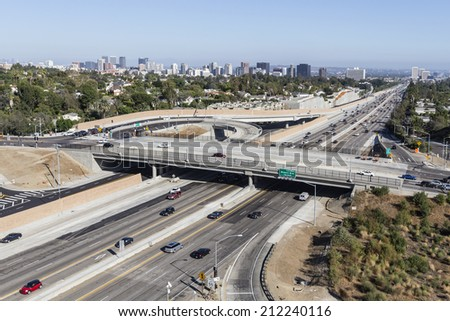 LOS ANGELES, CALIFORNIA - August 17, 2014:  Sunday afternoon traffic on Los Angeles's busy San Diego 405 Freeway at Sunset Blvd.   - stock photo