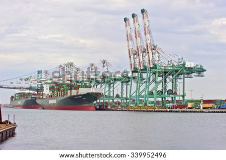 LOS ANGELES/CALIFORNIA - AUGUST 6, 2015: Taiwan's Evergreen & Italia's Marine container vessels being loaded at Port of Los Angeles, the largest port in U.S. Aug. 6, 2015 in San Pedro, California USA