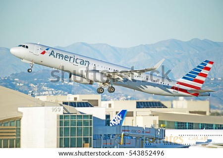 LOS ANGELES/CALIFORNIA - DEC. 17, 2016: American Airlines Airbus A321-231 aircraft is airborne as it departs Los Angeles International Airport, Los Angeles, California USA