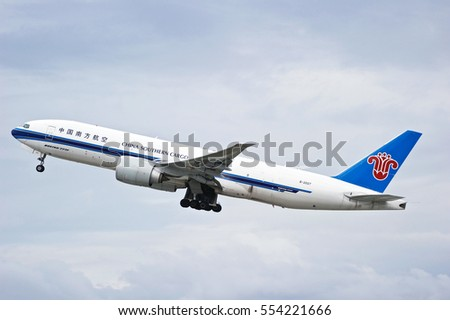 LOS ANGELES/CALIFORNIA - DEC. 30, 2016: China Southern (Cargo) Airlines Boeing 777-F1B aircraft is airborne as it departs Los Angeles International Airport, Los Angeles, California USA