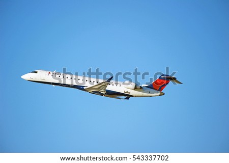 LOS ANGELES/CALIFORNIA - DEC. 17, 2016: Delta Connection CRJ-701ER aircraft is airborne as it departs Los Angeles International Airport, Los Angeles, California USA
