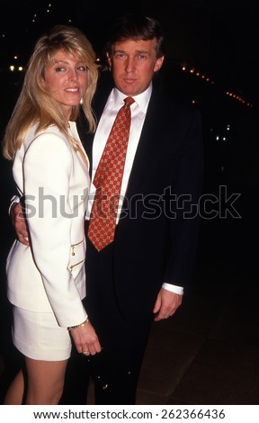 LOS ANGELES, CALIFORNIA - exact date unknown - circa 1990 - Donald Trump and second wife Marla Maples arriving at a celebrity event - stock photo