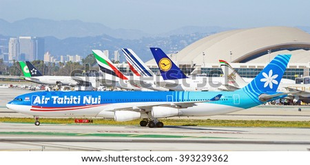 LOS ANGELES/CALIFORNIA - FEB. 21, 2016: Air Tahiti Nui Airbus A340 taxiing along runway at Los Angeles International Airport, Los Angeles, California USA   - stock photo