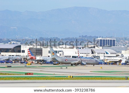 LOS ANGELES/CALIFORNIA - FEB. 21, 2016: Alaska Airlines Boeing 737-890 taxiing along runway as it arrives at Los Angeles International Airport, Los Angeles, California USA   - stock photo