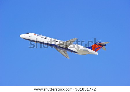 LOS ANGELES/CALIFORNIA - FEB. 21, 2016: Delta Airlines commercial jet is airborne as it departs Los Angeles International Airport, Los Angeles, California USA - stock photo