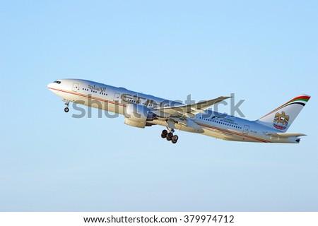 LOS ANGELES/CALIFORNIA - FEB. 21, 2016: Etihad Airways Boeing 777-237 (LR) as it departs Los Angeles International Airport in Los Angeles, California, USA  - stock photo
