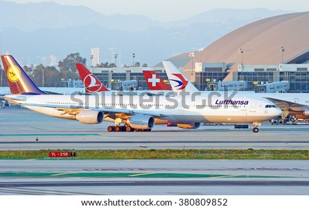 LOS ANGELES/CALIFORNIA - FEB. 21, 2016: Lufthansa Airbus 340-642 taxiing along runway before departure at Los Angeles International Airport, Los Angeles, California USA - stock photo