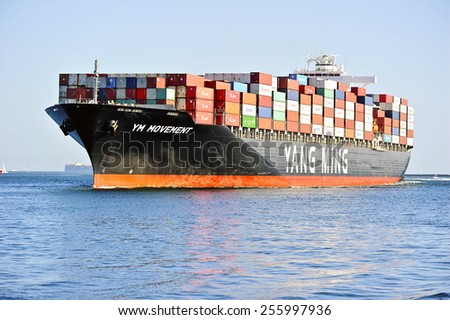 LOS ANGELES/CALIFORNIA - FEBRUARY 8, 2015: Yang Ming Marine Transport ship arrives at the Port of Los Angeles, the largest port in USA February 8, 2015 in San Pedro, California USA  - stock photo