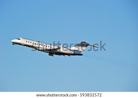 LOS ANGELES/CALIFORNIA - JAN 27, 2017: Privately owned Bombardier BD700 fixed wing multi-engine aircraft is airborne as it departs Los Angeles International Airport, Los Angeles, California USA