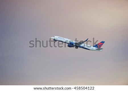 LOS ANGELES/CALIFORNIA - JULY 23, 2016: Delta Airlines aircraft is airborne as it departs Los Angeles International Airport amidst a smoke filled sky from the Sands fire, Los Angeles, California USA