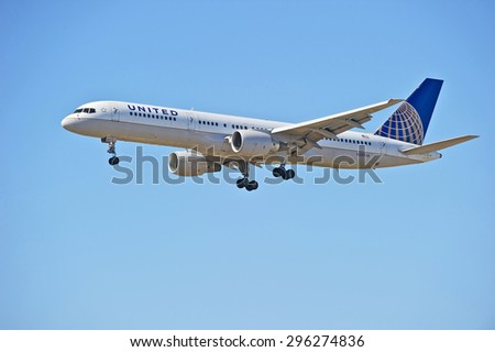 LOS ANGELES/CALIFORNIA - JULY 12, 2015: United Airlines Boeing 757-200 on approach to runway at Los Angeles International Airport in Los Angeles, California, USA - stock photo