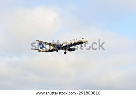 LOS ANGELES/CALIFORNIA - JUNE 13, 2015: US Airways commercial jet on approach to runway at Los Angeles International Airport in Los Angeles, California, USA