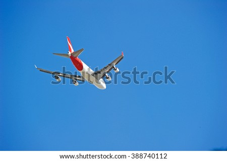 LOS ANGELES/CALIFORNIA - MARCH 9, 2016: Qantas Airlines commercial jet approaching Los Angeles International Airport for a landing, Los Angeles, California USA - stock photo