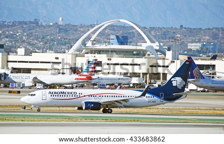 LOS ANGELES/CALIFORNIA - MAY 22, 2016: Aeromexico Boeing 737 commercial aircraft taxiing along runway upon arrival to Los Angeles International Airport, Los Angeles, California USA - stock photo