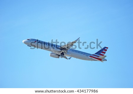 LOS ANGELES/CALIFORNIA - MAY 22, 2016: American Airlines Airbus A321 commercial aircraft is airborne as it departs Los Angeles International Airport, Los Angeles, California USA  - stock photo