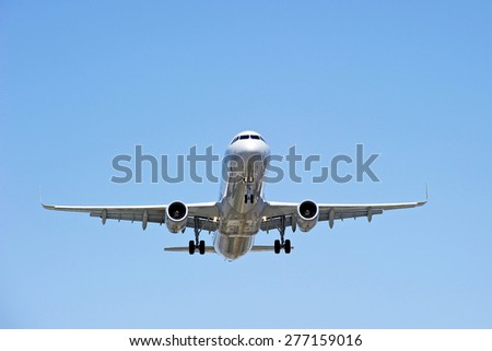 LOS ANGELES/CALIFORNIA - MAY 10, 2015: Commercial airliner approaches runway for a landing at Los Angeles International Airport in Los Angeles, California, USA - stock photo