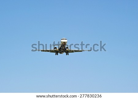 LOS ANGELES/CALIFORNIA - MAY 10, 2015: Commercial airliner jet on approach to runway at Los Angeles International Airport in Los Angeles, California, USA