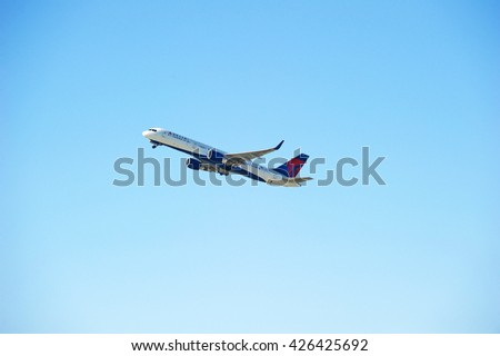 LOS ANGELES/CALIFORNIA - MAY 21, 2016: Delta Air Lines Boeing 757 commercial aircraft is airborne as it departs Los Angeles International Airport, Los Angeles, California USA