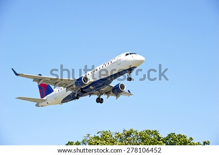 LOS ANGELES/CALIFORNIA - MAY 10, 2015: Delta Airlines commercial jet on approach to runway at Los Angeles International Airport in Los Angeles, California, USA - stock photo