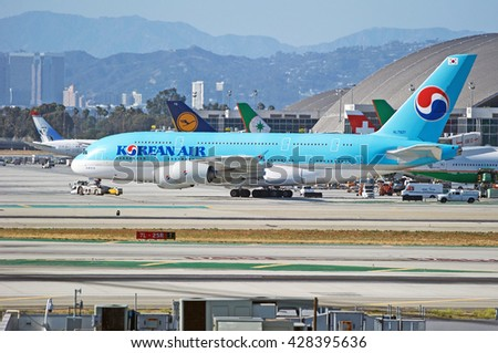 LOS ANGELES/CALIFORNIA - MAY 22, 2016: Korean Air Airbus A380-861 is being towed along the tarmac from the terminal at Los Angeles International Airport. Los Angeles, California USA - stock photo