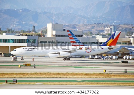 LOS ANGELES/CALIFORNIA - MAY 22, 2016: Philippines Airlines Airbus A340 commercial aircraft taxiing along the tarmac upon arrival to Los Angeles International Airport, Los Angeles, California USA - stock photo