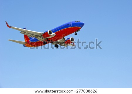 LOS ANGELES/CALIFORNIA - MAY 10, 2015: Southwest Airlines commercial jetliner on approach to runway at Los Angeles International Airport in Los Angeles, California, USA - stock photo