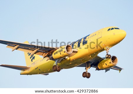 LOS ANGELES/CALIFORNIA - MAY 22, 2016: Spirit Airlines Airbus A319 commercial aircraft approaching the runway for a landing at Los Angeles International Airport, Los Angeles, California USA - stock photo