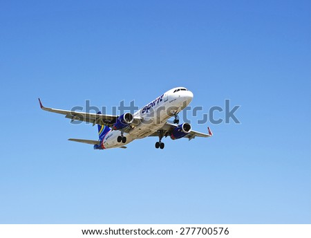 LOS ANGELES/CALIFORNIA - MAY 10, 2015: Spirit Airlines Airbus 320 commercial jet on approach to runway at Los Angeles International Airport in Los Angeles, California, USA - stock photo