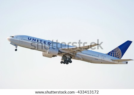 LOS ANGELES/CALIFORNIA - MAY 22, 2016: United Airlines Boeing 777-222ER commercial aircraft is airborne as it departs Los Angeles International Airport, Los Angeles, California USA - stock photo