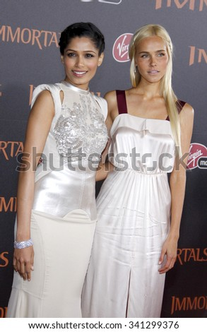 "LOS ANGELES, CALIFORNIA - November 7, 2011. Isabel Lucas and Freida Pinto at the World premiere of ""Immortals"" held at Nokia LA Live, Los Angeles."
