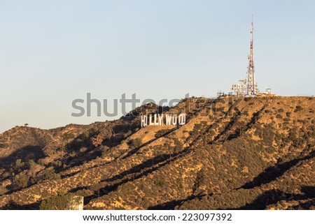 LOS ANGELES, CALIFORNIA - October 5, 2014:  Warm early morning light on the Hollywood sign and Mt Lee in Los Angeles's popular Griffith Park.   - stock photo