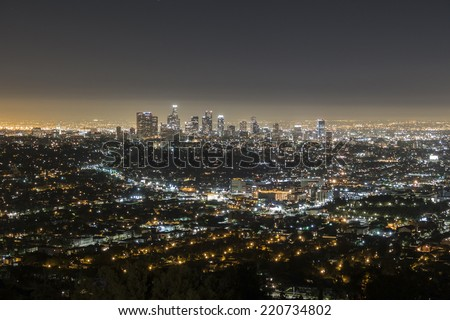 LOS ANGELES, CALIFORNIA - September 30, 2014:  Predawn glow of downtown Los Angeles viewed from Griffith Park in the Hollywood Hills. - stock photo