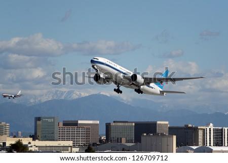 LOS ANGELES, CALIFORNIA, USA - JANUARY 28: China Southern Airlines Boeing 777 takes off from Los Angeles Airport on January 28, 2013. It has the most powerful jet engines in commercial service.
