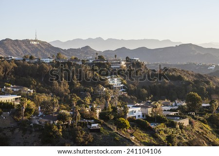 LOS ANGELES, CALIFORNIA, USA - January 1, 2015:  Hollywood Hills homes and the Hollywood Sign in the Santa Monica Mountains above Los Angeles. - stock photo